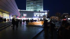Baku Central Railway Station at dusk and 28 May metro station. Baku, Azerbaijan - Circa 2019: Wide angle view of people walking near old building of Baku Central stock video