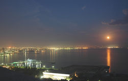 Baku city at night. And reflection of moon in the water Royalty Free Stock Photos