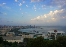 Baku Common Afternoon Cityscape View. Baku Scenic Afternoon Cityscape View of the Coastal Area and Cloudy Sky royalty free stock images
