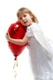 Balão do coração da terra arrendada da menina Fotografia de Stock