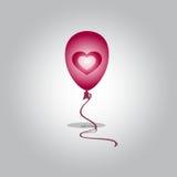 Balão do voo com coração Fotos de Stock