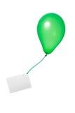 Balão verde com cartão Fotografia de Stock Royalty Free