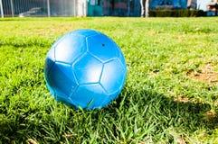 Balón de fútbol azul Imagen de archivo libre de regalías