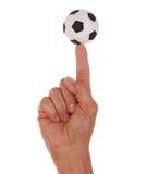 Balón de fútbol balanceado en el dedo Imágenes de archivo libres de regalías