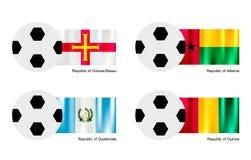 Balón de fútbol con la bandera de Guinea-Bissau, de Albania, de Guatemala y de Guinea Fotografía de archivo