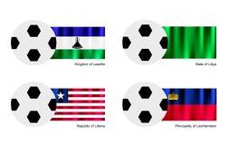 Balón de fútbol con la bandera de Lesotho, de Libia, de Liberia y de Liechtenstein Imagen de archivo