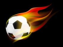Balón de fútbol con las llamas Fotografía de archivo