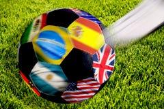 Balón de fútbol con los indicadores Imagen de archivo libre de regalías