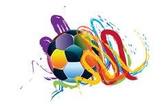 Balón de fútbol con los movimientos del cepillo Foto de archivo libre de regalías