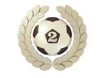 Balón de fútbol de plata con el número 2 en una guirnalda del laurel Fotos de archivo libres de regalías