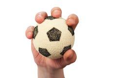 Balón de fútbol del asimiento de la mano Fotografía de archivo libre de regalías