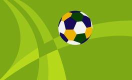 Balón de fútbol del Brasil en el fondo verde Imagen de archivo