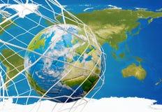 Balón de fútbol del globo de la tierra en red del fútbol meta 3D-Illustration Ele Fotos de archivo libres de regalías