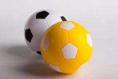 Balón de fútbol del juguete del negro y del yelow Fotografía de archivo