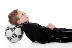 Balón de fútbol del muchacho Fotografía de archivo