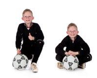 Balón de fútbol del muchacho Foto de archivo