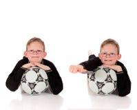 Balón de fútbol del muchacho Imágenes de archivo libres de regalías