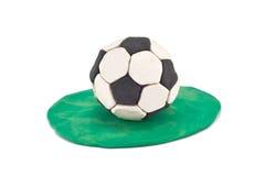 Balón de fútbol del Plasticine en hierba foto de archivo libre de regalías