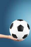 Balón de fútbol disponible Imagen de archivo libre de regalías