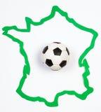 Balón de fútbol en el contorno Francia Imagenes de archivo