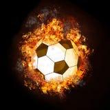 Balón de fútbol en el fuego Imágenes de archivo libres de regalías