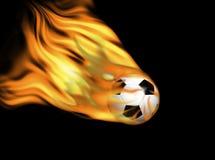 Balón de fútbol en el fuego Foto de archivo libre de regalías