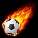 Balón de fútbol en el fuego Fotografía de archivo