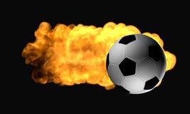 Balón de fútbol en el fuego Imagen de archivo libre de regalías