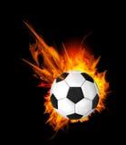 Balón de fútbol en el fuego Foto de archivo