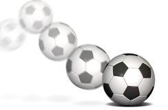 Balón de fútbol en el movimiento imagen de archivo