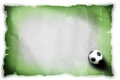 Balón de fútbol en el papel reciclado. Imagenes de archivo