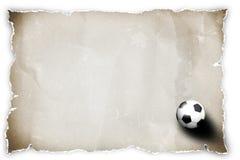 Balón de fútbol en el papel reciclado. Imagen de archivo libre de regalías
