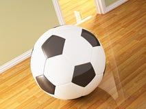 Balón de fútbol en el suelo de madera Imagen de archivo libre de regalías