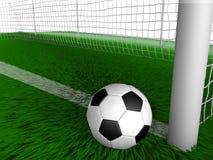 Balón de fútbol en fútbol de la hierba con los posts de la meta Fotos de archivo