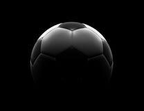 Balón de fútbol en fondo negro Fotografía de archivo