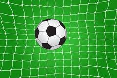 Balón de fútbol en la red Imagen de archivo