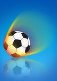 Balón de fútbol en llama Foto de archivo