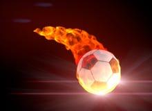 Balón de fútbol en llama de la energía Imagenes de archivo