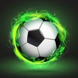Balón de fútbol en llama verde Imagen de archivo libre de regalías