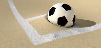 Balón de fútbol en una echada de la arena del desierto Fotos de archivo libres de regalías