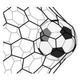 Balón de fútbol en una rejilla Foto de archivo libre de regalías