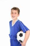 Balón de fútbol feliz de la explotación agrícola del muchacho Fotografía de archivo libre de regalías