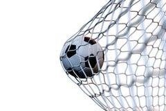 balón de fútbol de la representación 3d en meta en el movimiento Balón de fútbol en la red en el movimiento aislada en el fondo b Imagen de archivo libre de regalías