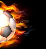 Balón de fútbol llameante Imágenes de archivo libres de regalías