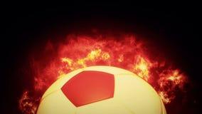 Balón de fútbol realista en el fuego ilustración del vector