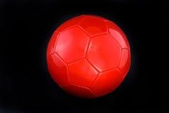 Balón de fútbol rojo Fotos de archivo libres de regalías