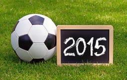 Balón de fútbol y Año Nuevo Imagen de archivo