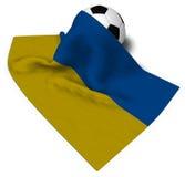 Balón de fútbol y bandera de la Ucrania Foto de archivo