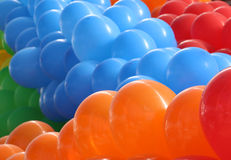 Balões alaranjados, azuis e vermelhos Fotografia de Stock Royalty Free