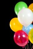 Balões Assorted em um fundo preto Fotografia de Stock Royalty Free